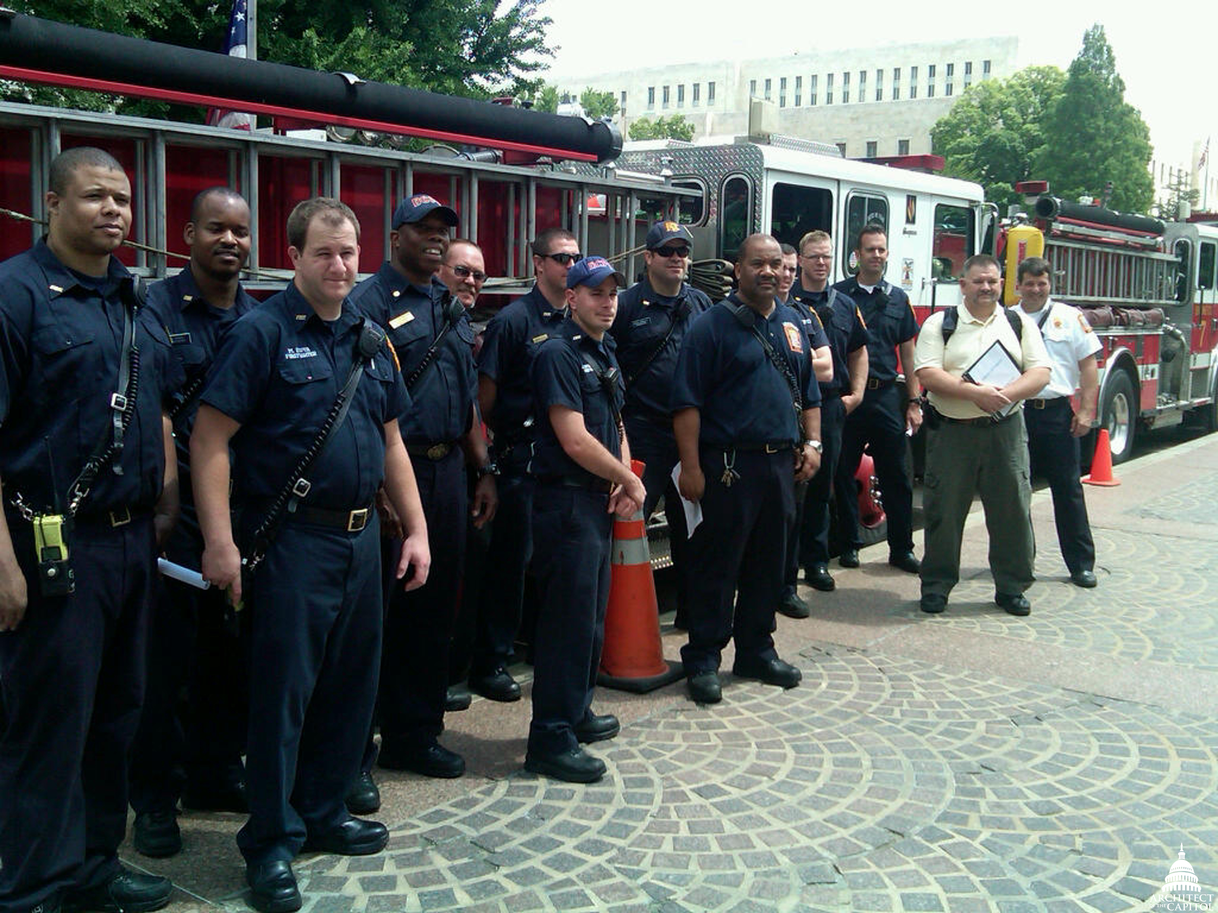 Photo from 2011 of DC firefighters getting ready to start familiarization tours of the Library of Congress Buildings.