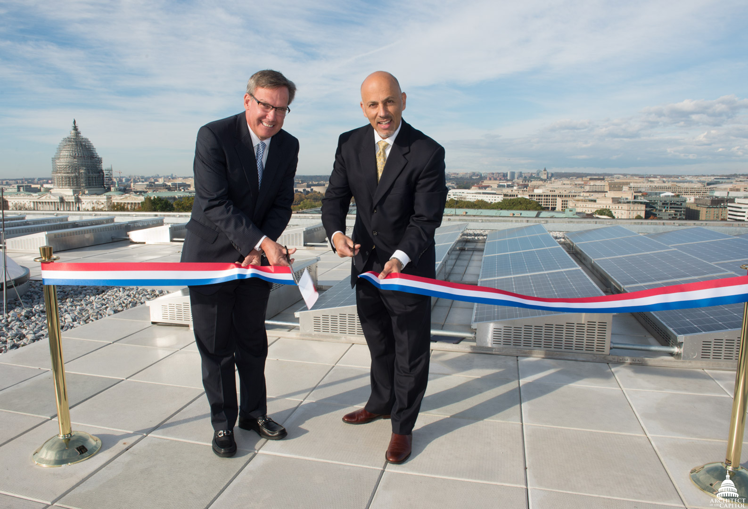 Ribbon cutting ceremony on the Hart Senate Office Building roof. Capitol Dome in background.