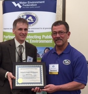 Photo of AOC's Tim Minner accepting the award from VWEA.