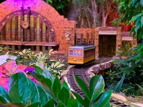 A trolley leaves Cincinnati Union Terminal model in the train show at the U.S. Botanic Garden.
