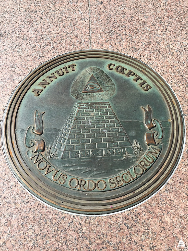 The reverse side of the seal includes an unfinished pyramid with the Roman numerals for 1776 at its base, as seen on a plaque in Freedom Plaza.
