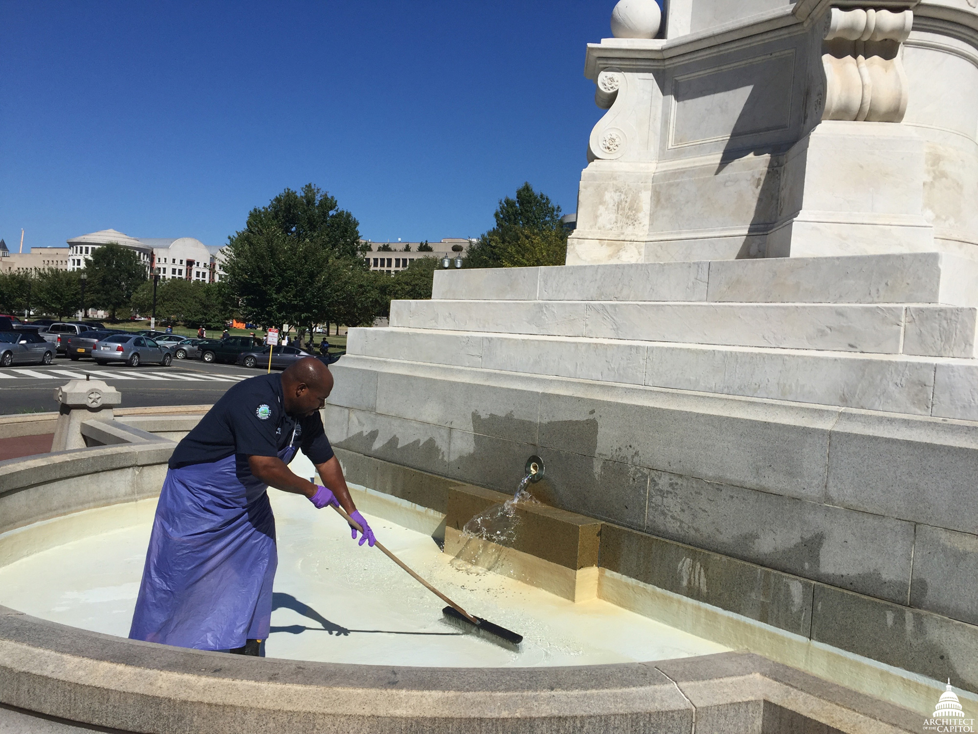 Cleaning the fountain at Peace Memorial.