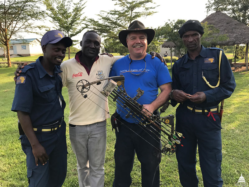 Bill Burns poses with some of the guards that work for KenyaRelief