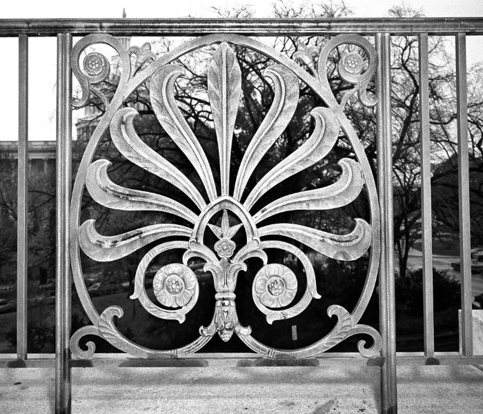 Panel of a bronze Longworth Building railing decorated with a stylized anthemion leaf.
