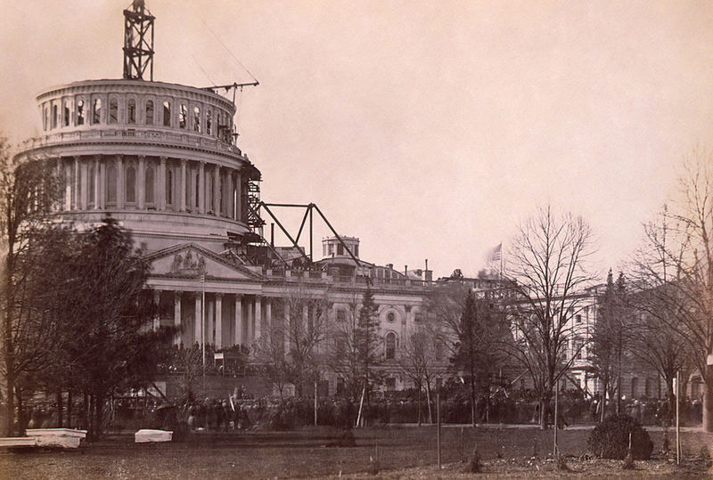 Lincoln's Inauguration, March 1861, with the U.S. Capitol Dome under construction in background.