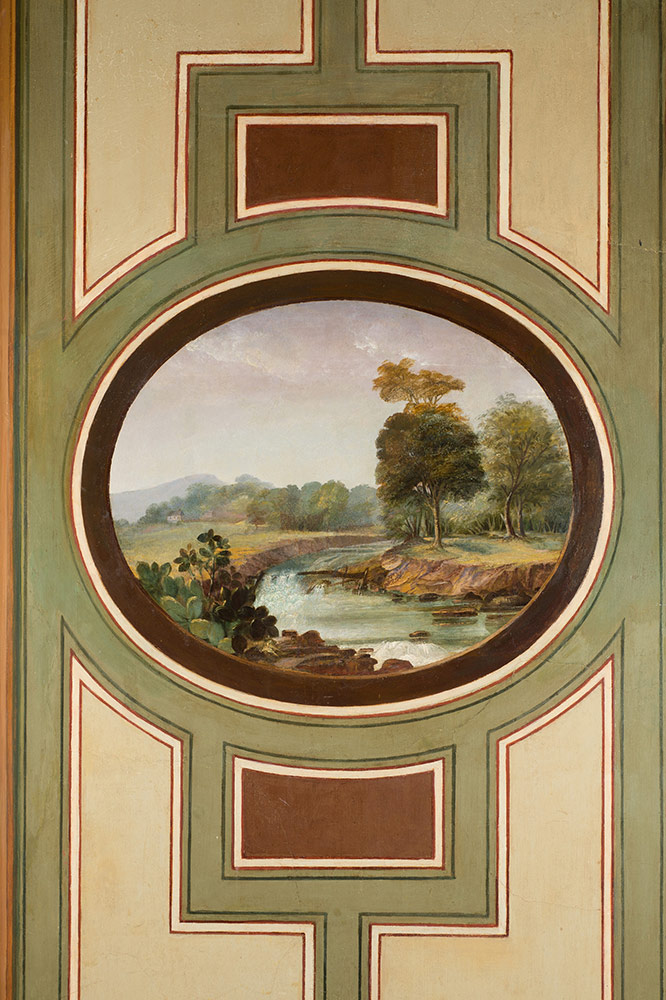 An oval medallion of landscape painted in the Brumidi Corridors.