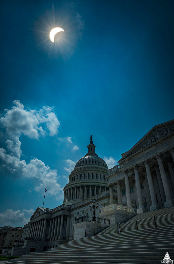 Partial solar eclipse seen above the U.S. Capitol.
