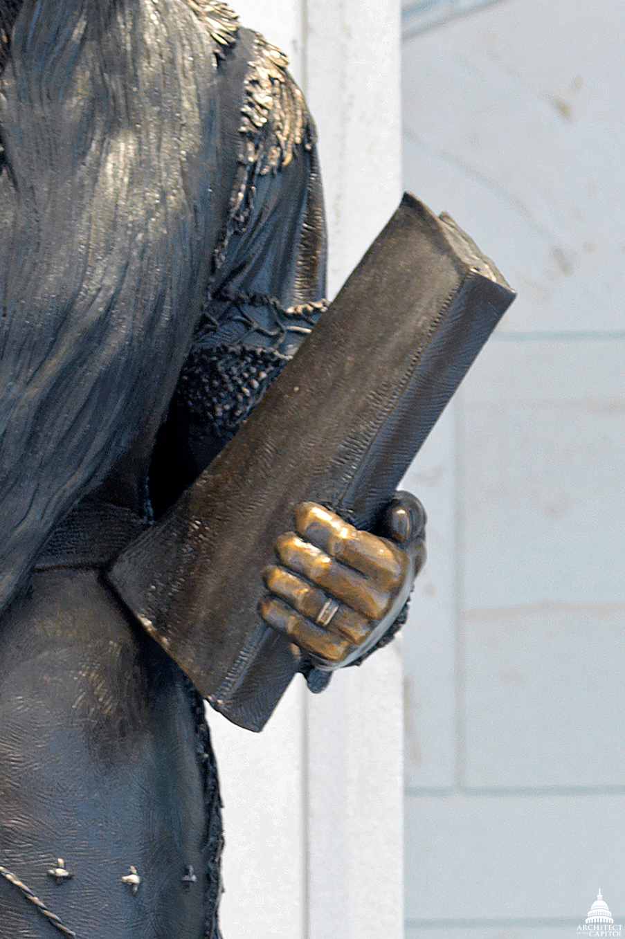 Detail of the book of Sarah Winnemucca's statue.