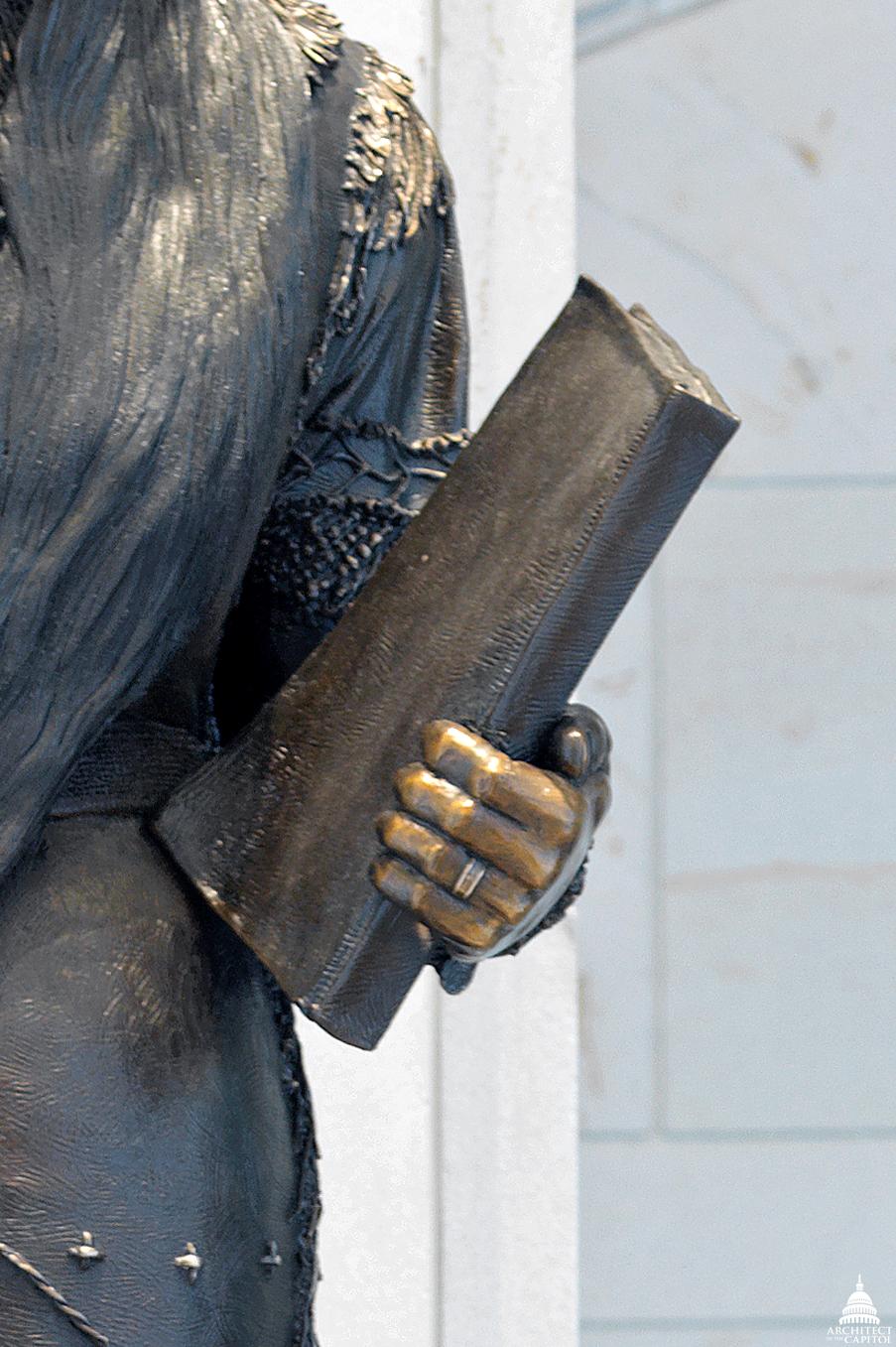 Detail of the book of Sarah Winnemucca's statue.