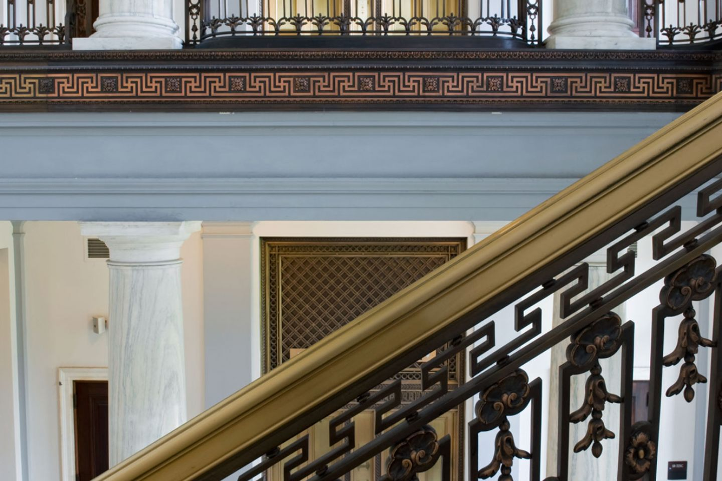 View of elevators and stair railings inside the Russell Senate Office Building.