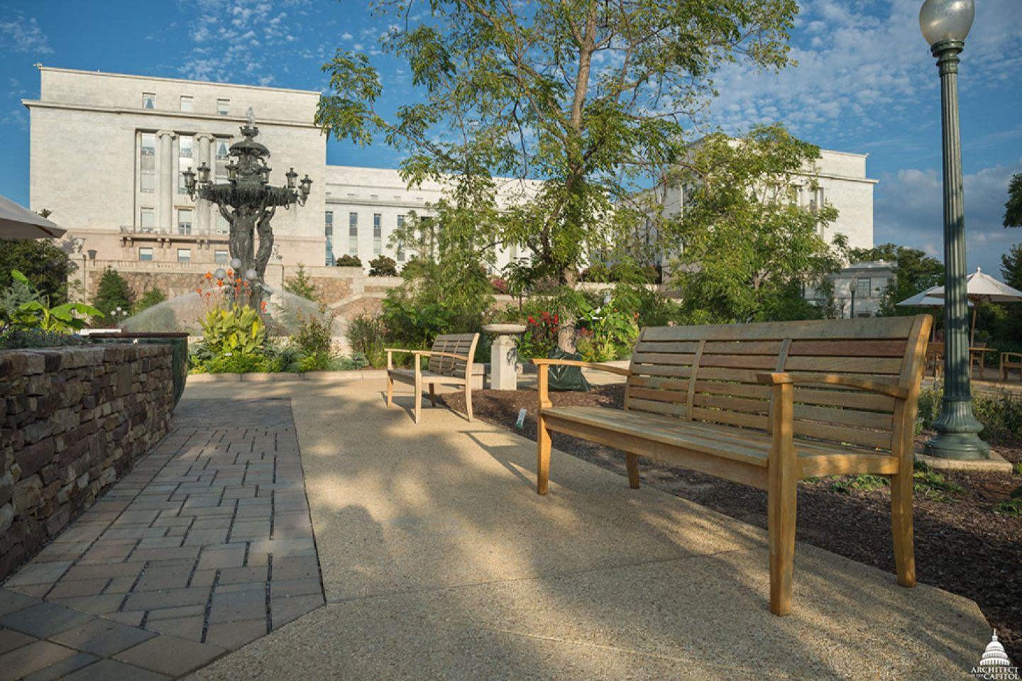 The park includes permeable pavement (left) and new furniture made from locally salvaged white oak.