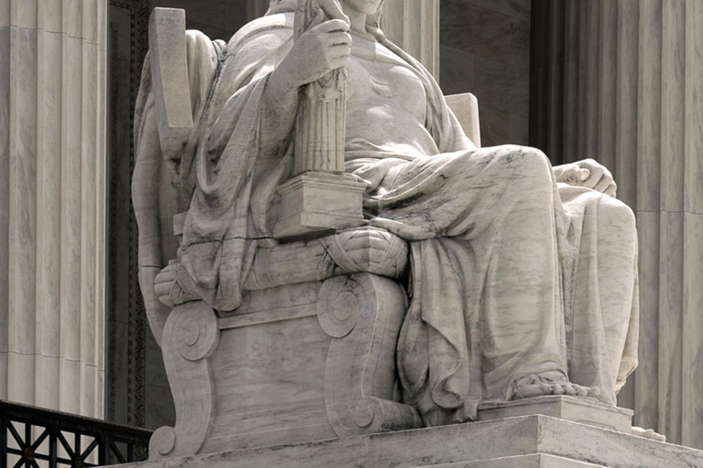 Statue of Contemplation of Justice by James Earle Fraser on the U.S. Supreme Court Building's main steps.