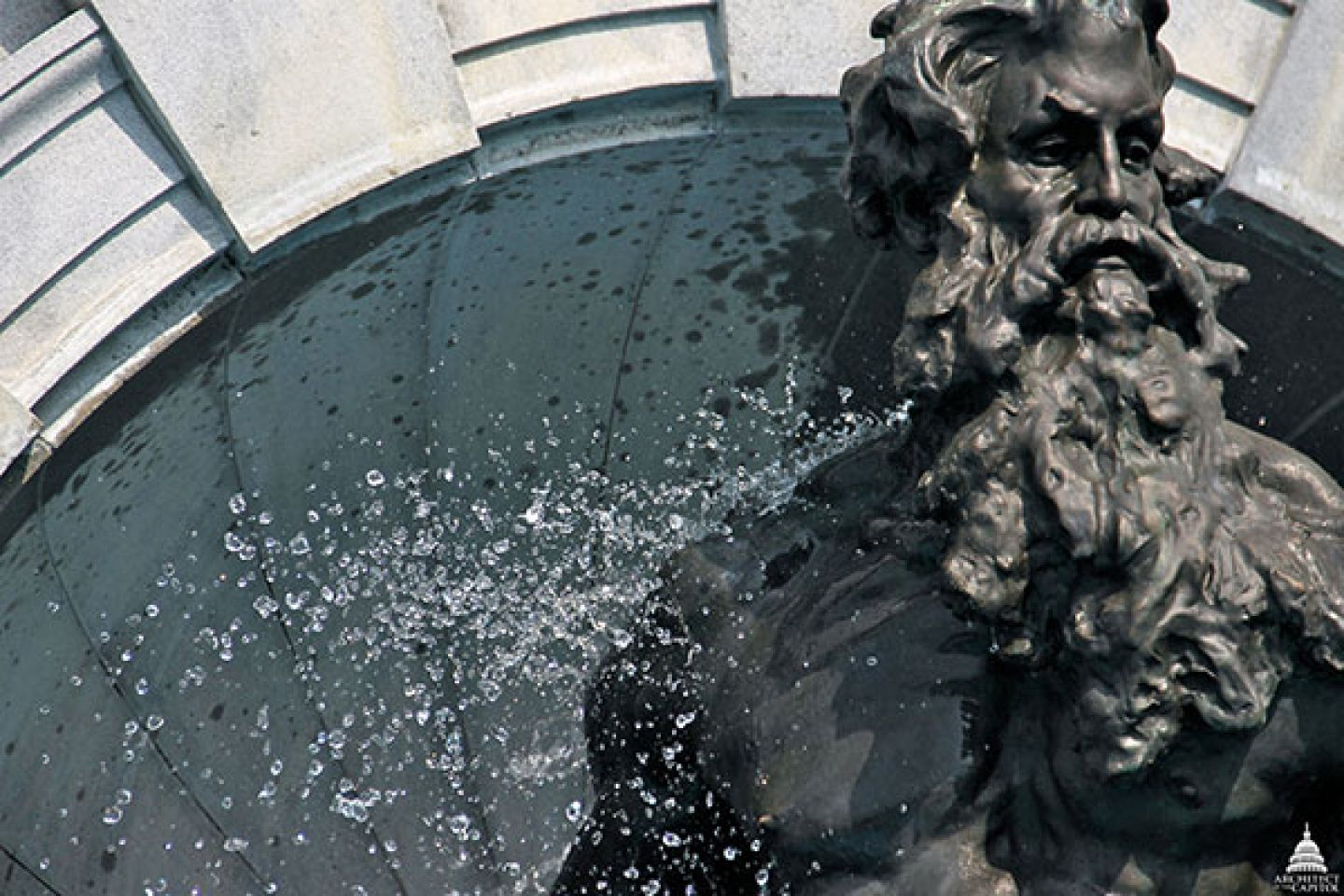 Detailed look at the Neptune sculpture element of the fountain at the Thomas Jefferson Building in Washington, D.C.