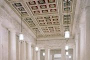 The main corridor, known as the Great Hall, has double rows of monolithic marble columns which rise to a coffered ceiling.