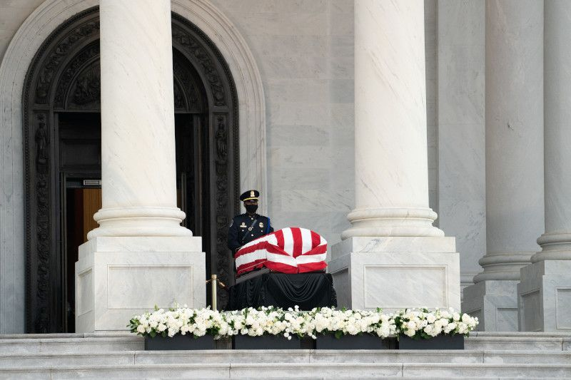 The United States Capitol Police stands guard over Representative Lewis' casket on the East Front Portico of the U.S. Capitol.