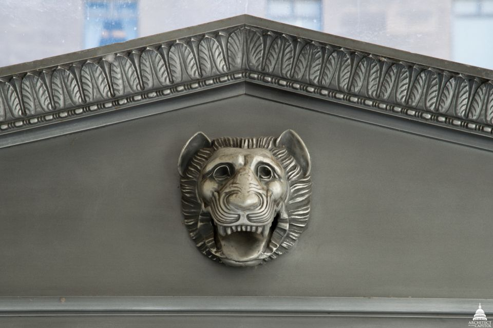 Lion head ornamentation above the door leading from the Rayburn Building foyer to its courtyard.
