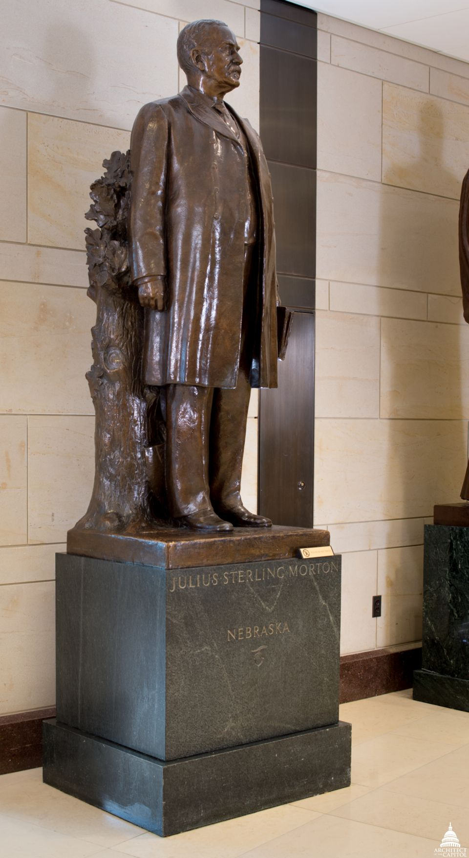 J. Sterling Morton's Capitol statue featuring a tree trunk, sapling, pruning shears and shovel symbolizing his founding of Arbor Day