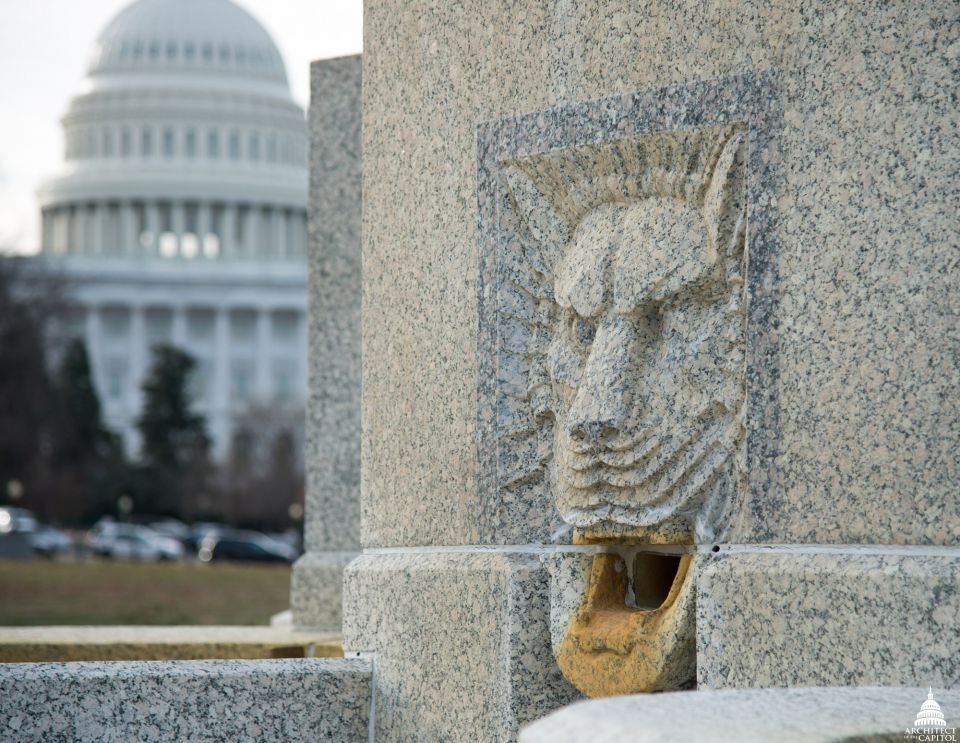 One of the lion-head spouts on the Senate Fountain.