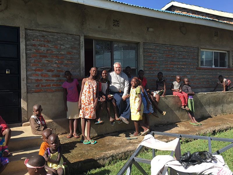 Bill Burns visits with children from the orphanage.