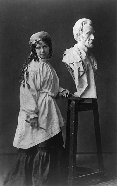 Vinnie Ream at work on her Lincoln bust, which rests upon the stand she used in the White House while President Lincoln posed for her.