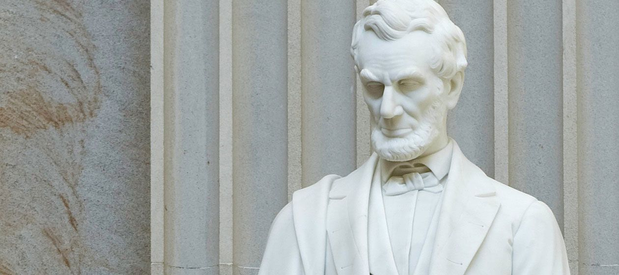 Close-up detail of Abraham Lincoln's statue in the U.S. Capitol Rotunda.