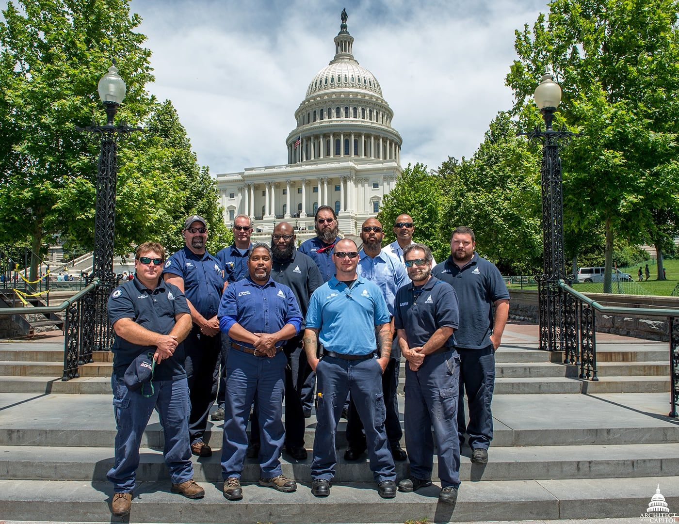 Group photo of the Architect of the Capitol high-voltage electricians on the West Front of the U.S. Capitol.