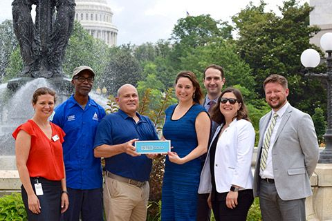 Members of the U.S. Botanic Garden and U.S. Green Building Council in Bartholdi Park with the SITES Gold Certification.