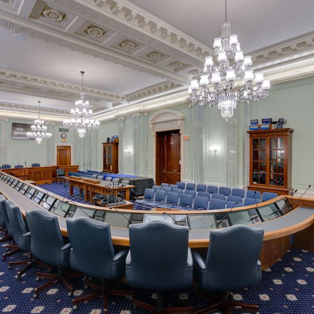 The finished SR-253 hearing room, with the ceiling and plaster reliefs repainted to appear like carved stone, which is truer to the architects' original intention.