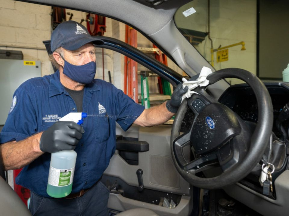 Richard Caselman completes the COVID-19 cleaning protocols for AOC vehicles.