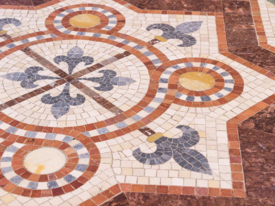 An example of inlaid encaustic tiles, or Minton tiles, featuring fleur de lis used in the flooring of the U.S. Capitol.