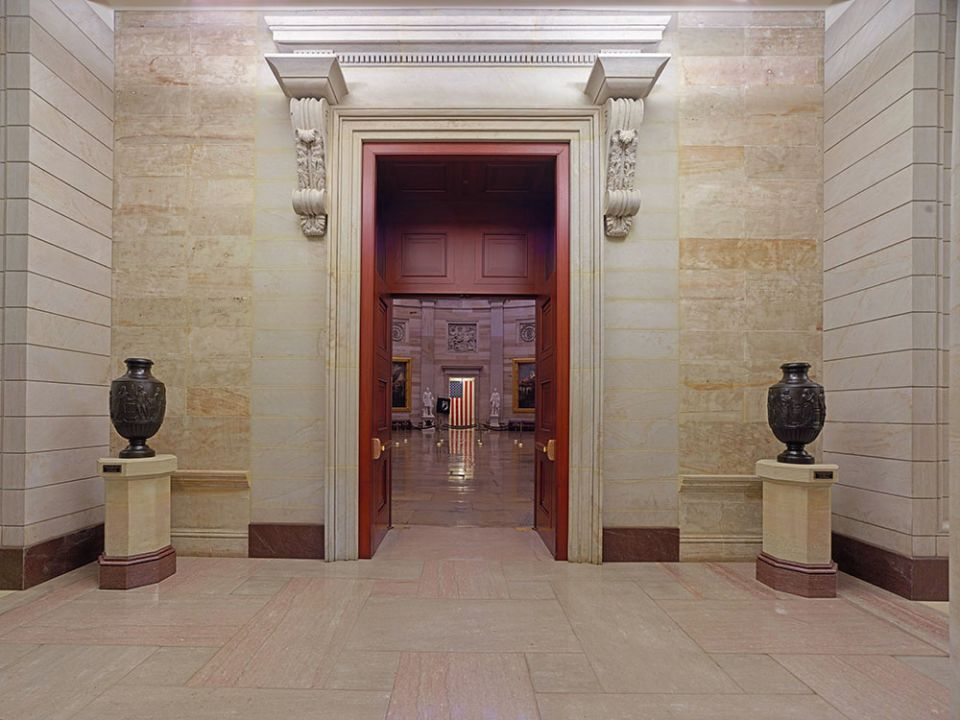 The bronze Federal Vases on display atop sandstone pedestals in the east front vestibule of the U.S. Capitol Rotunda.