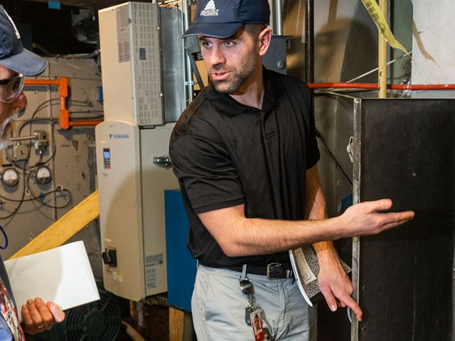 AOC employees discussing permit requirements during a self-inspection at the U.S. Capitol.