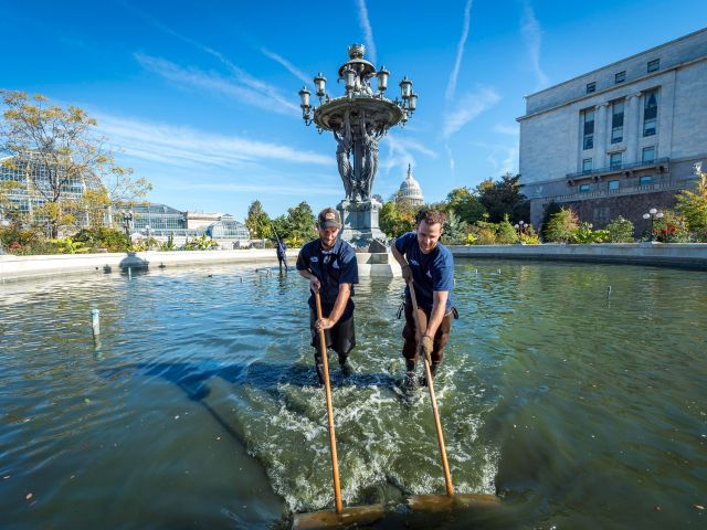 Workers cleaning Bartholdi Fountain