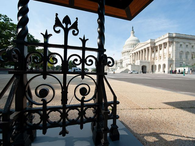 View of the U.S. Capitol's East Front from under the north trolley stop trellis.