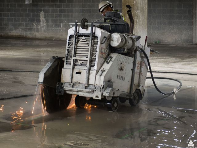 A saw-cutting machine was used to remove slabs of concrete so that new concrete and steel reinforcement could replace it.