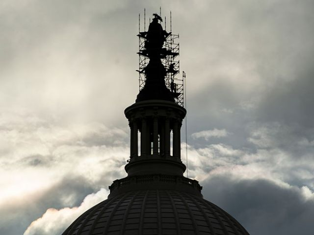 View of the Statue of Freedom surrounded by scaffolding for conservation atop the U.S. Capitol dome.