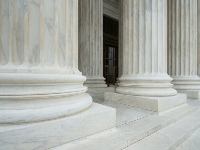 A portico of tall Corinthian columns gives the Supreme Court Building a monumental entrance.