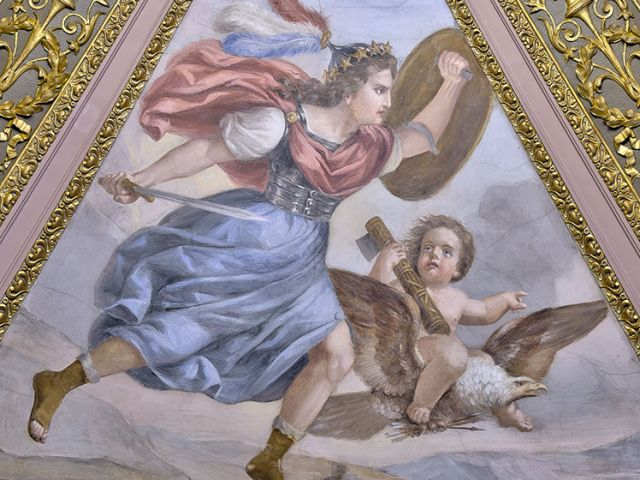 "Brumidi's ""War"" is portrayed by Minerva, goddess of wisdom and battle, flying across a landscape accompanied by a cherub riding on an eagle."