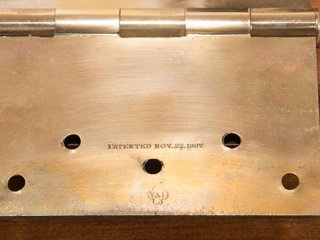 Close look at a door hinge in the Library of Congress Thomas Jefferson Building, patented Nov. 22, 1887.