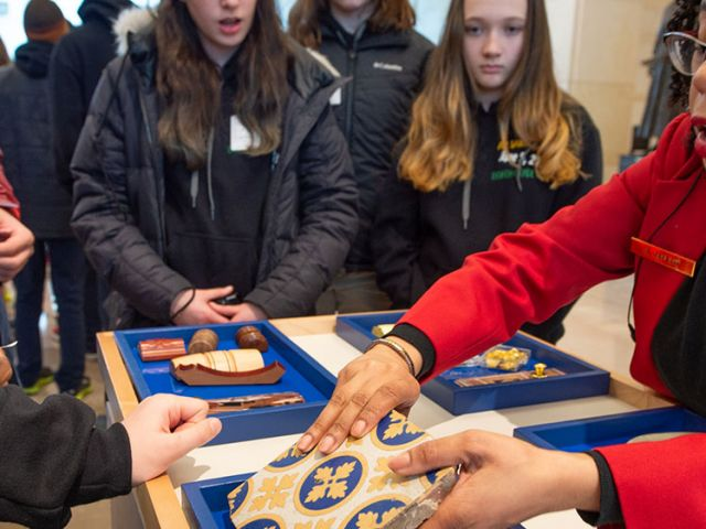 The Capitol Materials Cart being shown to visitors in Emancipation Hall.