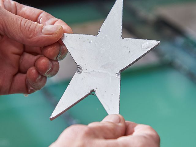A five-pointed star was cut within seconds by the Architect of the Capitol Sheet Metal Shop.