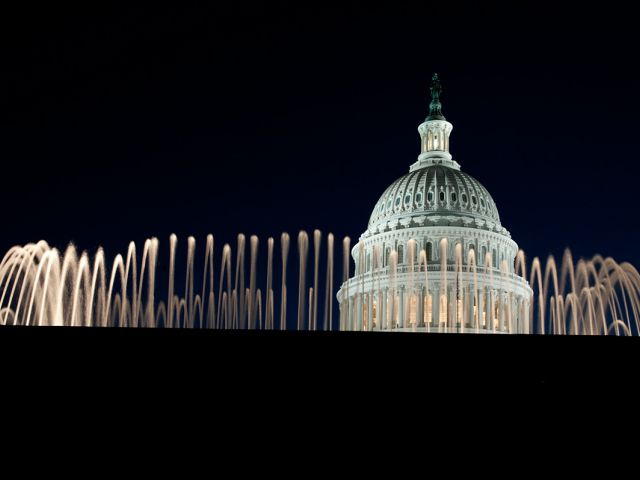 The Capitol Dome at night, as seen behind one of the East Front Olmsted fountains.