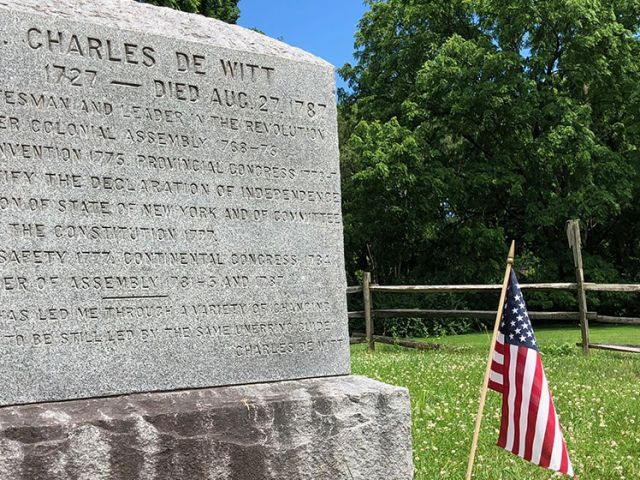 The tombstone of Colonel Charles De Witt. Born 1727 - Died Aug. 27, 1787. Patriot, statesman and leader in the revolution. Voting to ratify the Declaration of Independence.