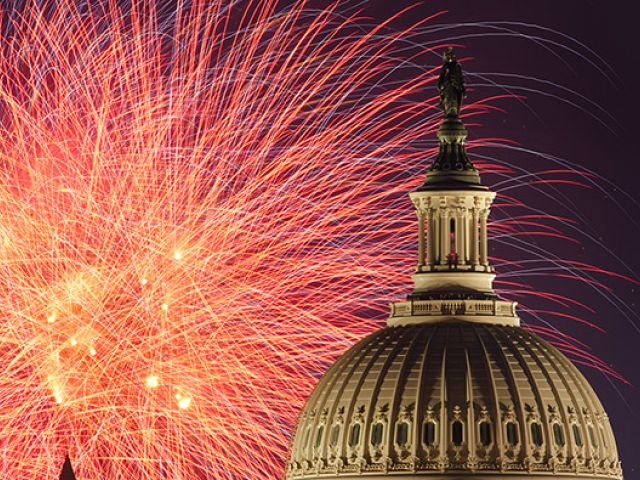 Fireworks bursting in the air with the U.S. Capitol dome on July 4th.