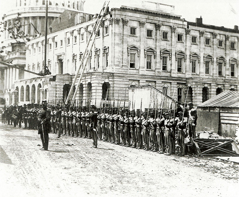 Civil War: Union soldiers stand at attention in front of the U.S. Capitol, 1861.
